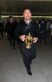 LONDON, ENGLAND - NOVEMBER 02: Keven Mealamu, of Rugby World Cup winners, the New Zealand All Blacks, carries the Webb Ellis Cup as the team arrive at Heathrow Airport at the start of their journey back to New Zealand on November 2, 2015 in London, United Kingdom. (Photo by David Rogers/Getty Images for England 2015)